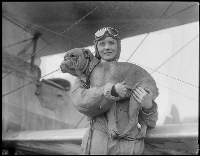 1928-05-27: Mrs. Dorothy Warrick, a student at East Boston Airport. From Pittsburg, PA. Wife of a Tech student flies with Hargenhaig, her 13 blue ribbon English bulldog.