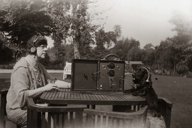 Dame Clara Butt (1872 - 1936) operating a communications radio with her dog, they are both wearing headphones, 1930 (Photo by Sasha/Getty Images)