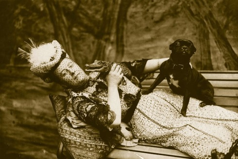 1908: A pup vies with a young crocodile for its owner's attention. (Getty Images)