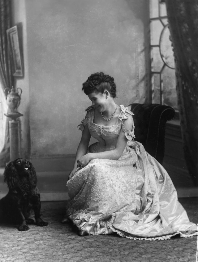 1890: A woman and her dog pose for a portrait. (Getty Images)