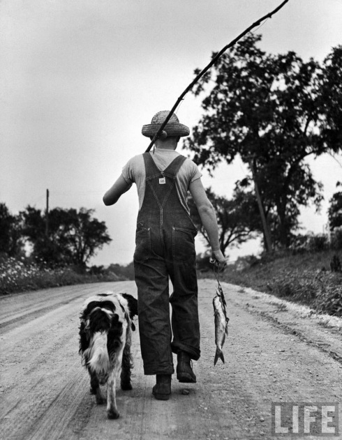 Off for home, Larry and Dunk trudge down the country road with a good-enough mess of fish.