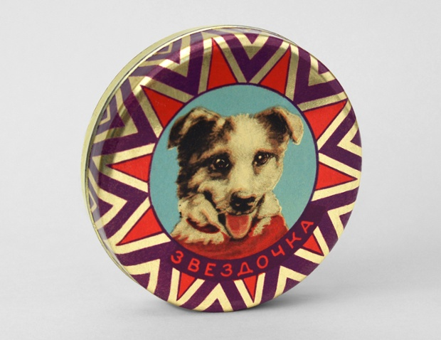 This Zvezdochka Confectionery tin from 1961 shows a portrait of space dog Zvezdochka.