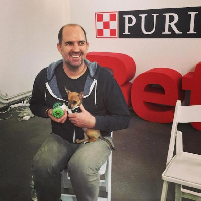 TurboRoo with Mark, who continues to design 3D-printed carts for the pup.