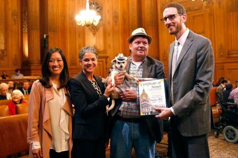 "(L-R) Supervisor Katy Tang, San Francisco Animal Care and Control Acting Director Miriam Saez, Frida, a female Chihuahua, dog owner Dean Clark and Supervisor Scott Wiener pose for a photograph after the San Francisco Board of Supervisors issued a special commendation naming Frida ""Mayor of San Francisco for a Day"" in San Francisco, California November 18, 2014. (Photo by Stephen Lam/Reuters)"