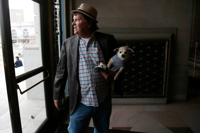 """Frida, a female Chihuahua, is carried into City Hall by owner Dean Clark before the San Francisco Board of Supervisors issues a special commendation naming Frida """"Mayor of San Francisco for a Day"""" in San Francisco, California November 18, 2014. (Photo by Stephen Lam/Reuters)"""