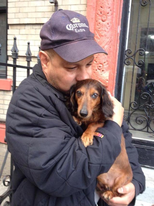 """Carlos and his dog Frank live in East New York, Brooklyn. """"He's like a little kid. He has his own blanket and he sleeps in bed."""" As Carlos was talking, he picked up Frank and held him close. """"He's my therapy."""""""